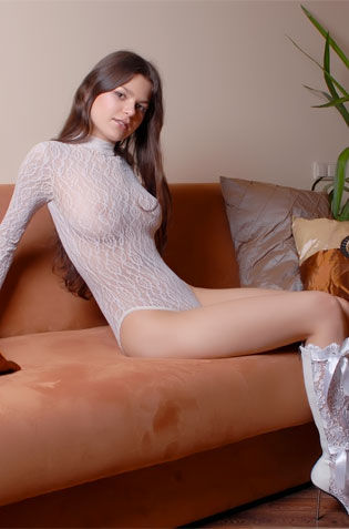 Sexy Teen On Fishnet Shows It All On Her Couch