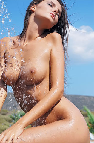 Russian Chick Showers Outdoors Naked