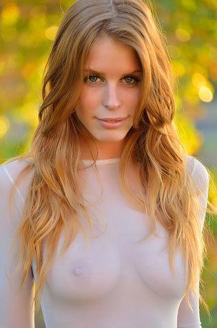 Redhead Babe In Her Seethru Upskirts