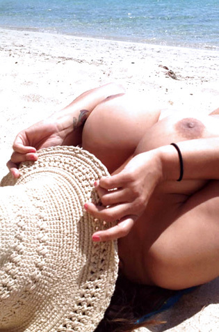 Monica Mendez Sun Tanning On The Beach In Spain