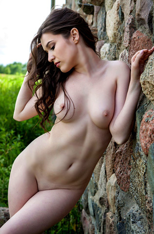 Doria Poses Nude Outdoors