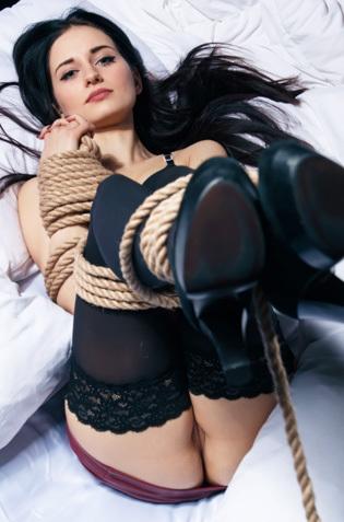 Beautiful Babe Eva Kahil Bondaged On A Bed