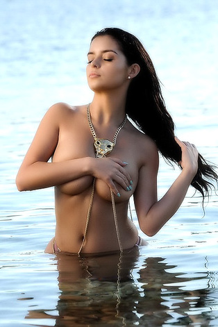 Busty Demi Rose Hiding Boobs At The Beach