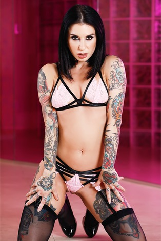 Queen Joanna Angel sports a new hairstyle looking rather seductive in pastel pink and black lacey lingerie complete with thigh h